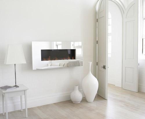 Un caldo inverno passa anche dal caminetto design and for Quanto consuma un camino elettrico